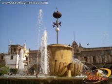 The city's crest is seen at the top of the fountain, Plaza Guadalajara